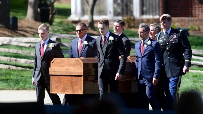 Pallbearers carry Billy Graham's casket into the funeral tent for private funeral service at the Billy Graham Library in Charlotte, N.C. on Friday, March 2, 2018.