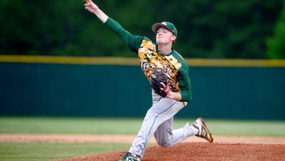 Reynolds' Josh Dotson delivers a pitch in the third