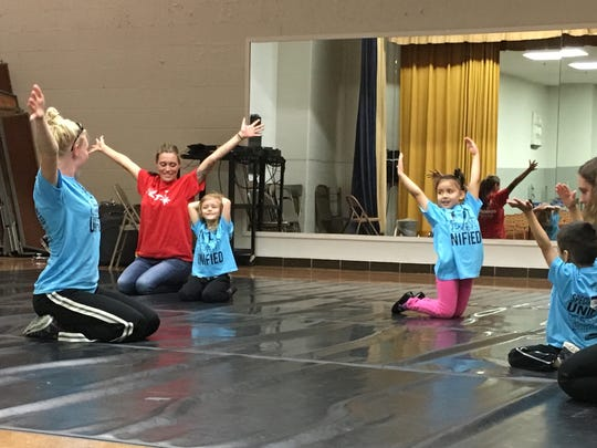 Students participate in yoga during Culver Family Learning Center's Special Olympics Unified Champion Schools program.