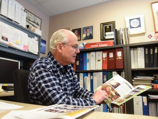 Boys & Girls Clubs Director Mark Sakry looks through
