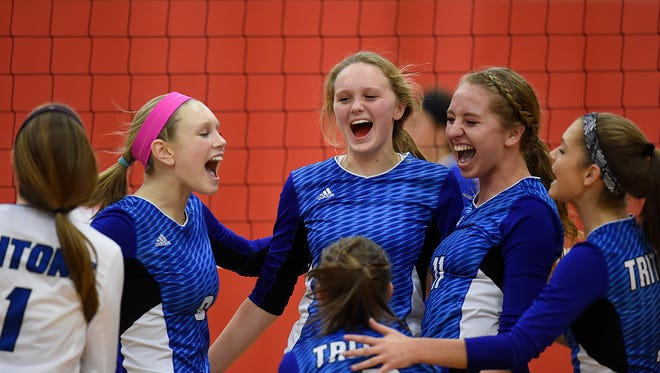 Green Bay Notre Dame players celebrate after winning game 3 and defeating Wrightstown during Thursday night's WIAA Div. 2 sectional semifinal volleyball match at Seymour Community High School in Seymour.