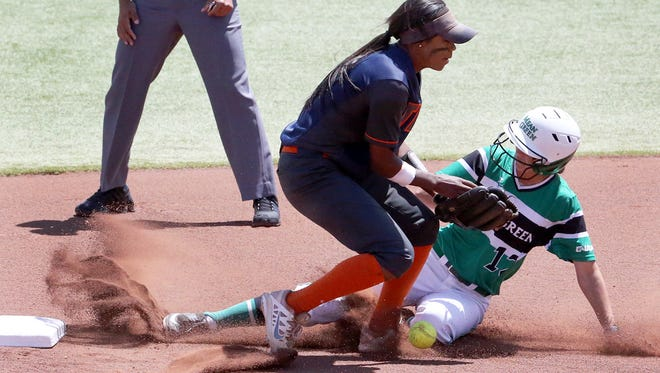 UTEP shortstop Cortney Smith tries to catch a low throw to second as Makenzi Dawson of North Texas slides in Sunday at Helen of Troy Field. The Miners won their last home game of the season 6-3.