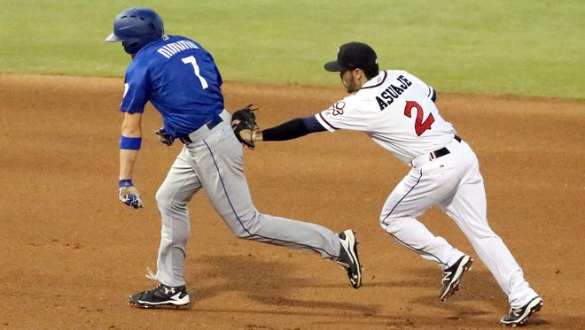Brandon Mimmo, 7, of the Las Vegas 51s gets caught in a rundown between second and third bases and is eventually tagged by Chihuahuas second baseman Carlos Asuaje, 2, Wednesday night at Southwest University Park.