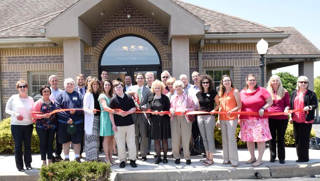 Rod Salter, center, financial advisor at Edward Jones, is joined by supporters during a ribbon-cutting Thursday, June 9, 2016 at 414 Phoenix Drive, Chambersburg.