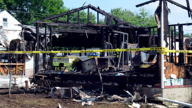 An early-morning fire in the 3000 block of Claremont Road in Dover Township destroyed one home and damaged two others on Friday, July 1, 2016. (John A. Pavoncello photo)