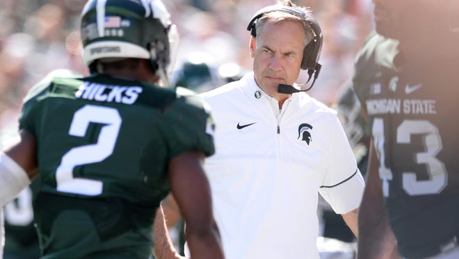 Head coach Mark Dantonio watches as his players come in to the bench during MSU's 30-6 loss to Wisconsin Saturday at Spartan Stadium.