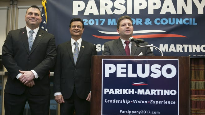 Parsippany Council candidates Chris Martino and Casey Parikh stand by mayoral candidate, council vice president Robert Peluso, who formally announced he will run for mayor at an event at Embassy Suites, Parsippany, NJ. Friday, Feb. 17, 2017. Special to NJ Press Media/Karen Mancinelli/Daily Record MOR 0217 Peluso for mayor