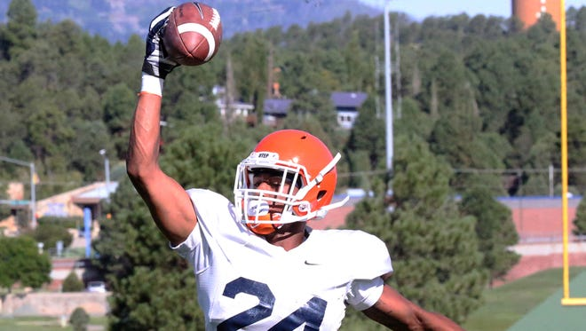 UTEP defensive back Kahani Smith leaps for a one-handed catch during drills Thursday at Camp Ruidoso. Thursday saw the first practice in shells.