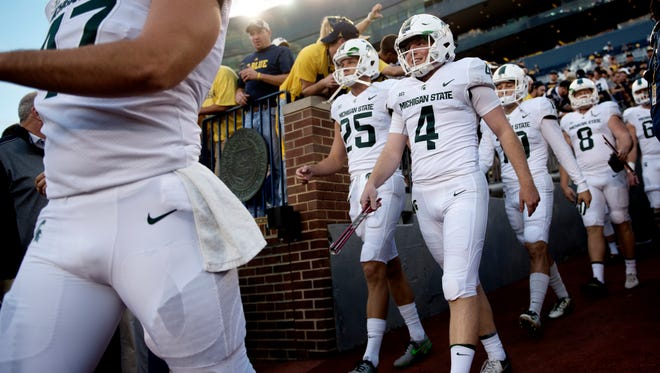 Members of the Michigan State football team make their way onto the field prior to their game against Michigan on Saturday, Oct. 7, 2017, at Michigan Stadium in Ann Arbor.