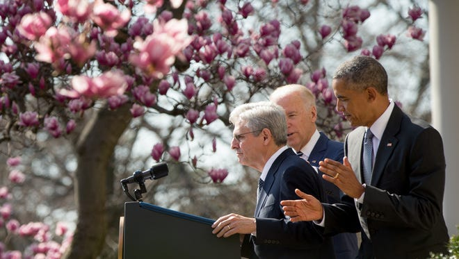 Merrick Garland, accompanied by President Obama and Vice President Biden, steps to the microphone as he is introduced as Obama's nominee for the Supreme Court during an announcement in the Rose Garden on March 16, 2016.