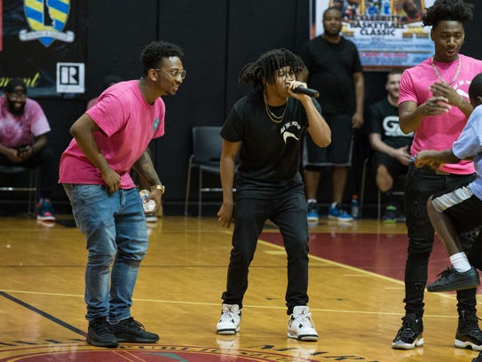 Asa the Prodigy, center, performs at James M. Bennett
