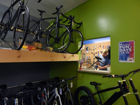 Doug Berling, owner of Freedom Bicycles, puts a bike