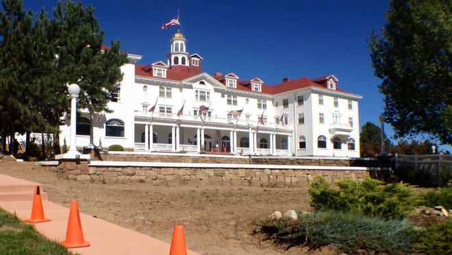 Construction is underway at the Stanley Hotel in Estes Park, Colo., as sidewalks are built to connect an eventual wedding and corporate retreat pavilion, site of the current pet cemetery.