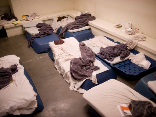 Stackable beds are used in a Vanderburgh County Jail holding cell to house an overflow of women inmates Thursday, Dec. 31, 2015. The women were ushered into an adjacent cell as the room was photographed.