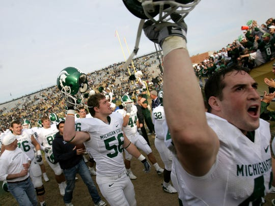 MSU players celebrate a 48-31 victory over Purdue on Nov. 10, 2007 at Ross-Ade Stadium.