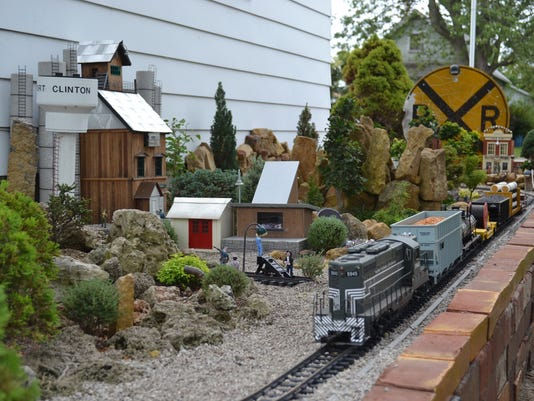Backyard Railroad Locomotives model railroad tracks its way through backyard garden