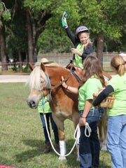 Special Equestrians in Fort Myers provides therapeutic horseback riding classes and equine-assisted activities to individuals with disabilities in our community. One of the ways to help is working in classes as a side walker (walking beside the rider to help them with support and verbal cues).