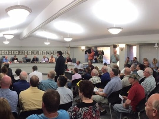 Residents packed the seats at a Webster planning board meeting Tuesday, August 16, to hear or speak about a proposed tomato greenhouse project.