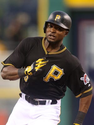 Jun 23, 2015; Pittsburgh, PA, USA; Pittsburgh Pirates right fielder Gregory Polanco (25) runs to third base with a triple against the Cincinnati Reds during the fourth inning at PNC Park.