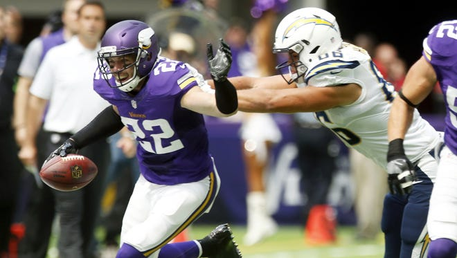 Minnesota Vikings free safety Harrison Smith runs from San Diego Chargers tight end Hunter Henry, right, after intercepting a pass during the first half of an NFL preseason football game Sunday, Aug. 28, 2016, in Minneapolis.