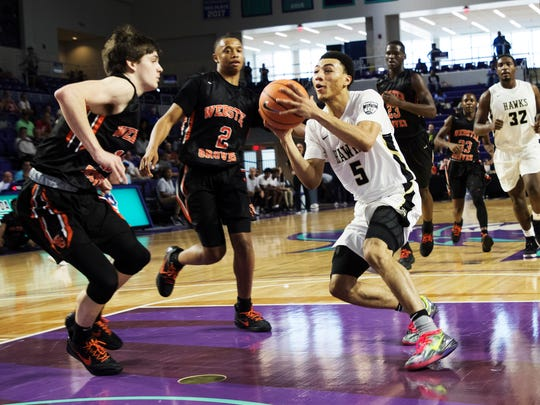 Hudson Catholic's Jahvon Quinerly goes to the basket against Webster Groves during the Culligan City of Palms Classic at Suncoast Credit Union Arena on Monday.  Hudson Catholic won 84-52. Quinerly had 18 points.