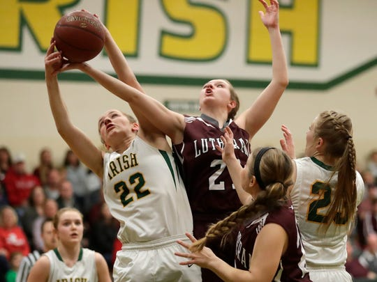 Taylor Haase (left) fights for a rebound during a WIAA Divisoin 3 regional final last season against Fox Valley Lutheran. Haase and the Irish are the top-ranked team in Divisions 3-5 in this week's area basketball poll. USA TODAY NETWORK-Wisconsin