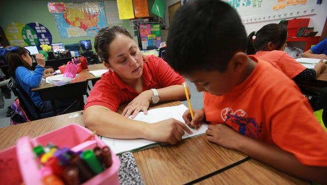 Anahi Mendoza assisted a student Friday.