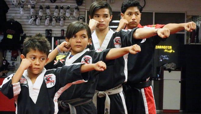 Christian Alvarado, 7, left, Alexa De La O, 10, Dominic Rubalcava, 17, and Robert Natera, 14, are part of the 8-member Warriors anti-bullying group. They practice karate out of Alchemy Karate at 1613 N. Zaragoza.