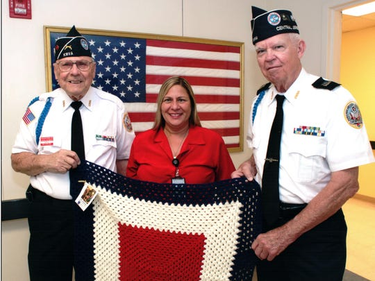 The Prayer Shawl Ministry at Our Lady of Victories Church in Sayreville gifted lap blankets recently to the Menlo Park Home veterans in Edison and to the Lyons Veterans Center at the Lyons Campus in Bernards. Plans are in the works to make a delivery to the Vineland Veterans Home later this month. From left: Leon Kaczmarek, parishioner of OLV and treasurer for Korean War Veterans Central Jersey Chapter 148; Denise Cracchiolo, service specialist at Lyons Veterans Campus; and Bob Bliss, commander, Korean War Veterans Chapter 148. For further information on the church's Prayer Shawl Ministry, call Carole Leppig at 732-254-1277.