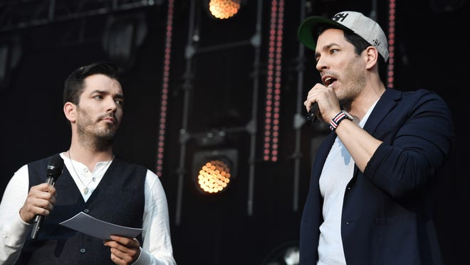 The Property Brothers, Jonathan and Drew Scott, speak to the crowd during the CMA Fest at Nissan Stadium Friday, June 9, 2017, in Nashville, Tenn.