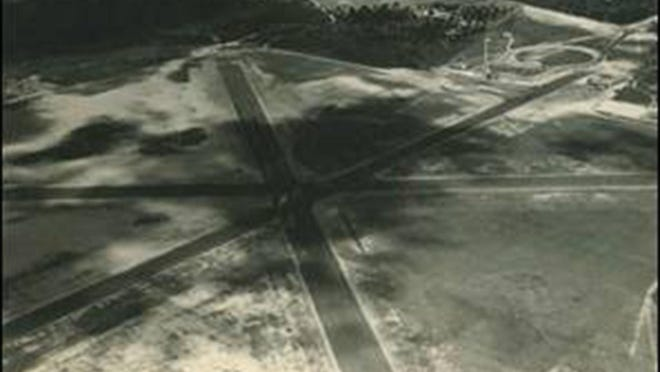 Aerial images of the Municipal Airport (now Hunter Army Airfield), from 5600EN-200 Engineering Department - Photographs.