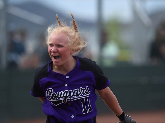 Spanish Springs' Carissa Andrews celebrates after scoring against Shadow Ridge during the NIAA softball state championships at Bishop Manogue in Reno on May 17, 2018.