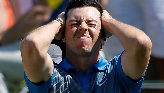 Rory McIlroy, of Northern Ireland, reacts after a bogey on the 18th hole at the Memorial golf tournament in Dublin, Ohio.