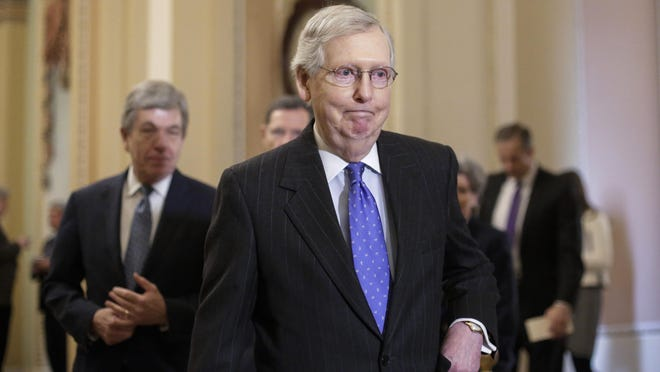 """In this Jan. 15, 2019, photo, Senate Majority Leader Mitch McConnell, R-Ky., arrives to speak to reporters following a weekly policy meeting on Capitol Hill in Washington. One of McConnell's guiding principles is: """"There's no education in the second kick of a mule."""" Now, deep in a government shutdown he wanted President Donald Trump to avoid, McConnell is not about to be kicked again."""
