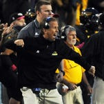 Southern Miss head coach Todd Monken yells during a play against North Texas on Saturday at M.M. Roberts Stadium.