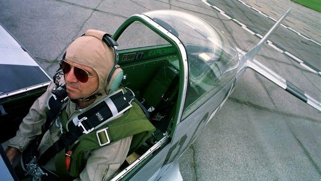 Jack Roush prepares his 1944 P-51D Mustang at Willow Run Airport in Ypsilanti on Aug. 20, 1999.
