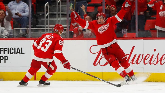 Red Wings center Dylan Larkin, right, celebrates his goal against the Ducks in the first period Tuesday at LCA.