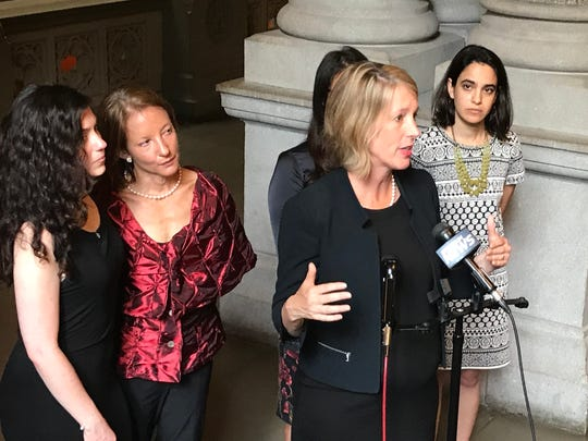 Democratic Attorney General hopeful Zephyr Teachout speaks at an Albany news conference on Monday, July 23, 2018, where victims of harassment called for public hearings. Elizabeth Crothers, in the red shirt, is attending the State of the Union with Rep. Joseph Morelle.
