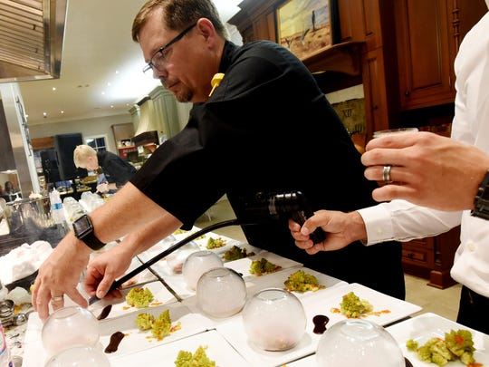 John Strand infuses his duck with apple wood smoke  for the Society of Golden Fork dinner Saturday evening at Kitchen and Bath Cottage. This is the sixth in a series of 12 dinners connected to the Louisiana Food Prize.