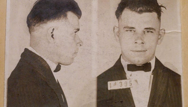 Invited guests gathered at the Historic Lake County Courthouse in Crown Point for the opening of the John Dillinger Museum, on the anniversary of Dillinger's escape,Tuesday March 3rd, 2015. Indiana Reformatory mug shots of John Dillinger (cq), stored in the state archives, shows the notorious gangster as a 21-year-old. Records show that Dillinger was admitted into the reformatory on Sept. 16, 1924. Charlie Nye/The Star.
