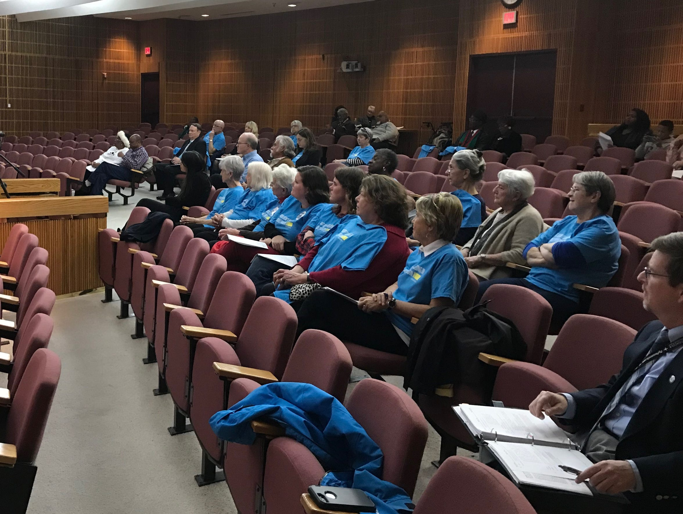Supporters of juvenile justice reform in blue shirts