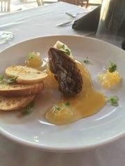 De Gaulle Square Bistro & Bar serves seared foie gras