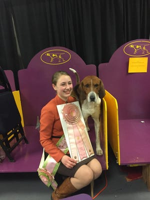 Sophia Rogers posing with her 6-year-old American foxhound, Bobby