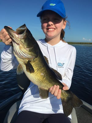 Natalie White, 11, of Fort Pierce, caught this bass over the summer while fishing with her dad, Kyle, and Capt. Mike Shellen of Okeechobeebassfishing.com. With the full moon on the way Oct. 5, expect bass to be in pre-spawning mode.