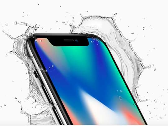 Ad showing Apple's iPhone X with water splashing around it
