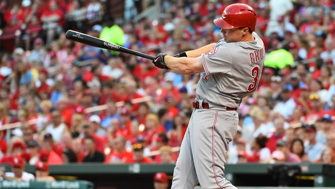 Cincinnati Reds right fielder Jay Bruce (32) hits a solo home run off of St. Louis Cardinals starting pitcher John Lackey (not pictured) in the first inning at Busch Stadium.