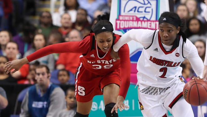 Louisville Cardinals forward Myisha Hines-Allen (2) gets the steal and dribbles the ball while chased by North Carolina State Wolfpack center Akela Maize (32) in the second half at the Greensboro Coliseum during the semifinals of the ACC Womens Tournament in Greensboro, North Carolina, on Saturday, March 3, 2018.