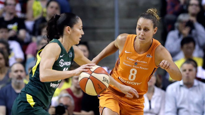 Seattle Storm's Sue Bird, left, tries to drive past Phoenix Mercury's Stephanie Talbot in the first half in a WNBA basketball playoff semifinal Tuesday, Aug. 28, 2018, in Seattle.