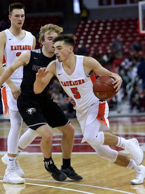 Kaukauna's Jordan McCabe drives past Westosha Central's Nic Frederick in a Division 2 boys state semifinal Friday in Madison.