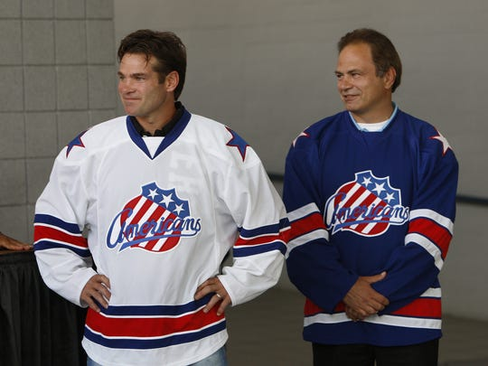 Amerks legends Chris Taylor, left, and Jody Gage. Taylor, 45, rejoins the club as head coach, the 12th former player so named.